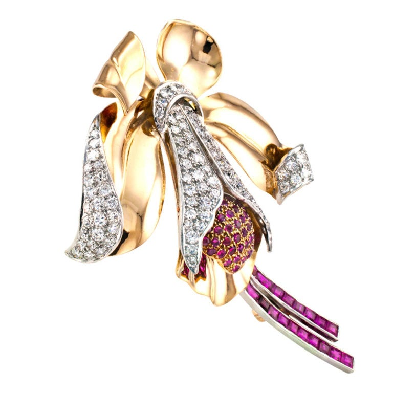 Retro Orchid Ruby and Diamond Brooch  Undeniable retro styling and scale unfolding into the shape of one of the most exotic and unusual flowers in the world, known for their ability to draw attention, while all at once evoking elegance, innocence