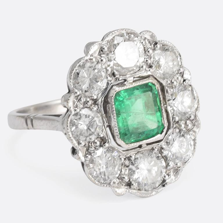 This stunning antique cluster ring dates to the late Edwardian period, and is home to a, exquisite central emerald – of excellent colour – and a 1.72ct cluster of brilliant cut diamonds. The ring is modelled in 18k white gold, with the stones set in