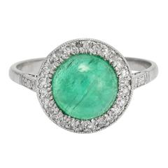 1920s Art Deco Emerald Cabochon Diamond Halo Ring