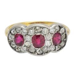 Edwardian Ruby and Diamond Three-Stone Halo Ring