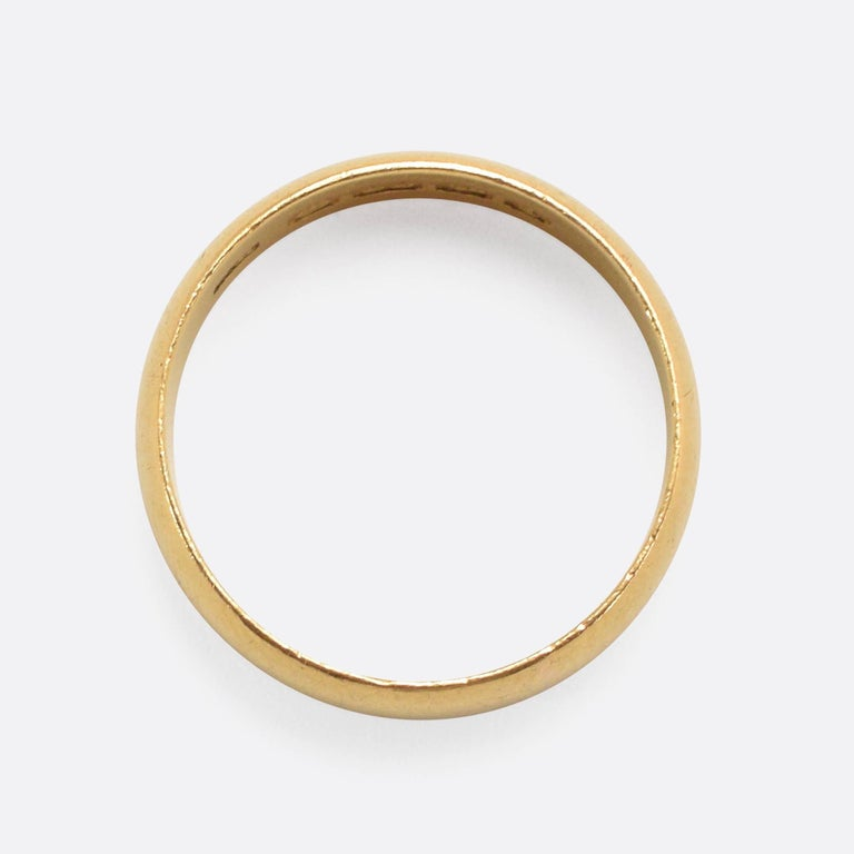 92a2c40ec A classic antique wedding band modelled in 22k gold. The piece has a 6.2mm