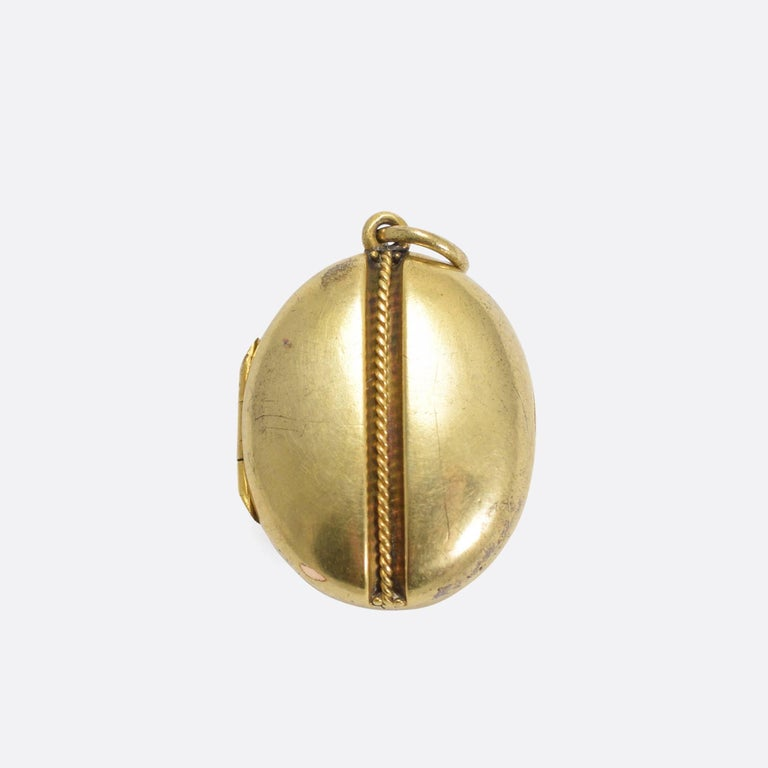 An elegant smaller-scale antique locket, set on the front with a shield-shaped bloodstone panel that remains uncarved. It's modelled in 15k gold, with the original glass fittings inside still present.  STONES Bloodstone Panel  MEASUREMENTS 2.1 x