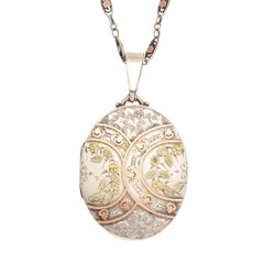 Antique Victorian Silver Oval Locket with Applied Gold Details