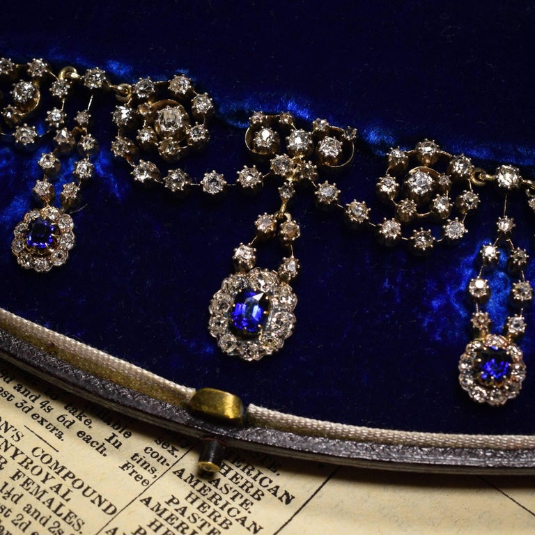 A spectacular ornate collar necklace - in its original fitted presentation box - by the esteemed Bell Brothers of Doncaster. It's modelled in 15k gold with silver settings, and is home to over 14 carats of old and rose cut diamonds, as well as three