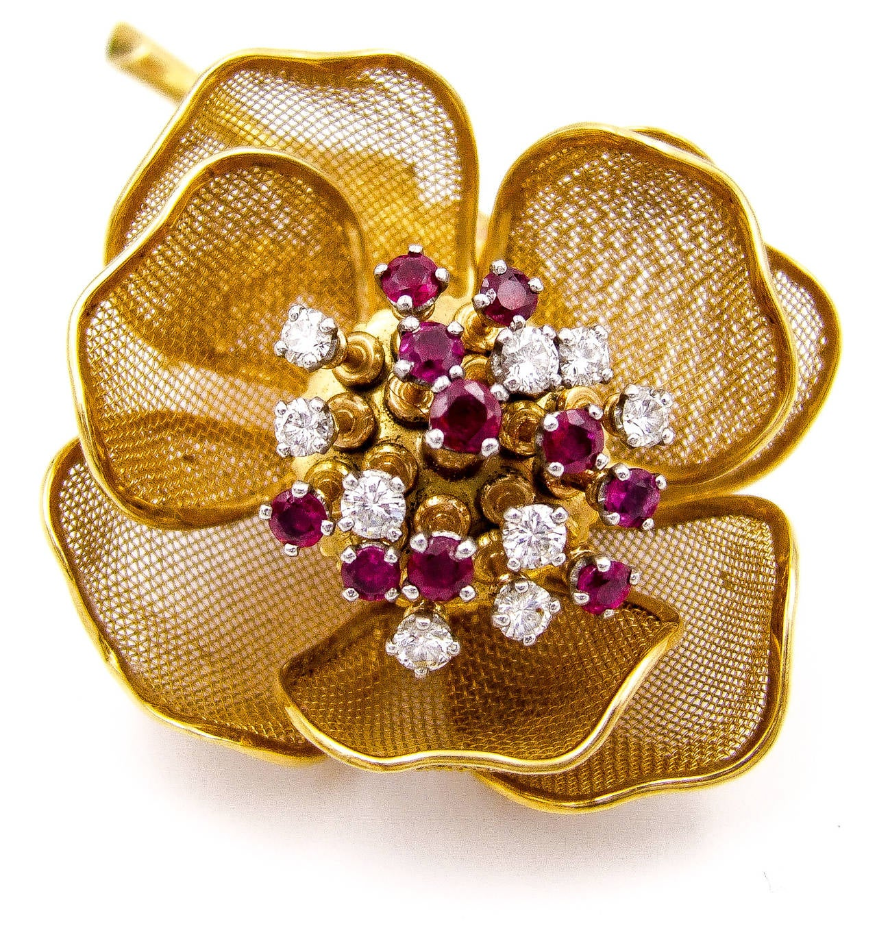 For the flower lover, this brooch is a welcome addition to a gold garden. The center pistils are set with rubies and diamonds which move (en tremblant) as the wearer moves. The delicate mesh petals surrounding the center can be opened or closed