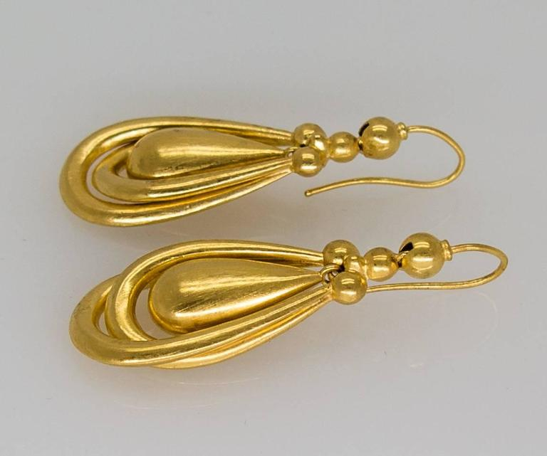 Elegant, graceful and wearable antique earrings for experienced collectors and newbies alike.   The smooth shepherd's hook slips easily thru the earhole, and the lightness of the earring assures that you'll wear them constantly.  The softly