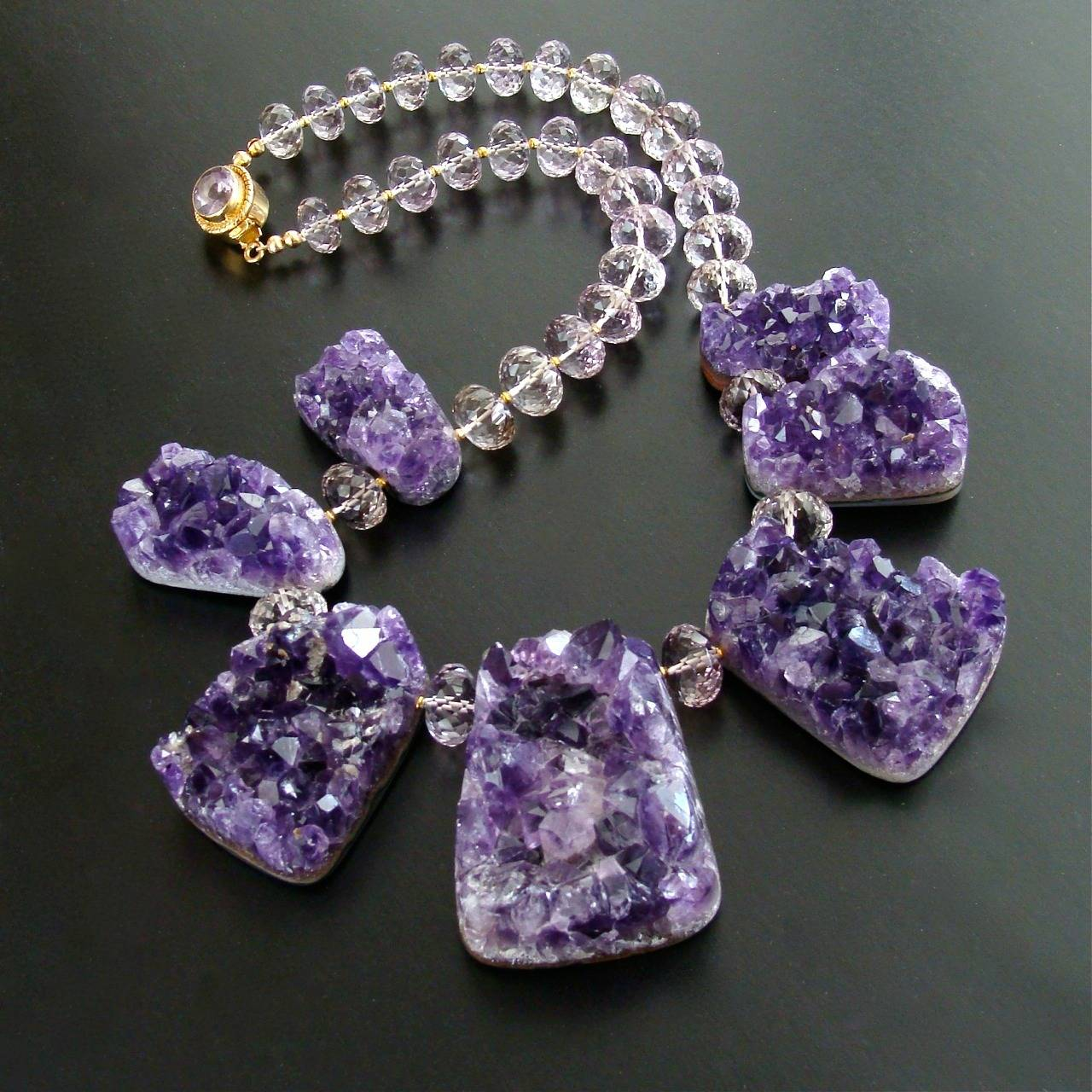 Seven specimen slabs of sparkling mystical amethyst crystal druzys have been combined with beautifully faceted graduated pink amethyst rondelles to create this jaw-dropping necklace.  The druzy slabs are absolutely mesmerizing and create an earthy
