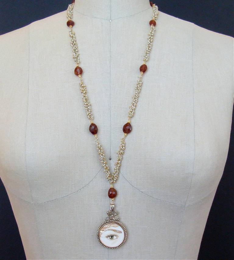 Victorian Pearl Mourning Locket Seed Pearl Hessonite Garnet Lover's Eye Necklace For Sale 1