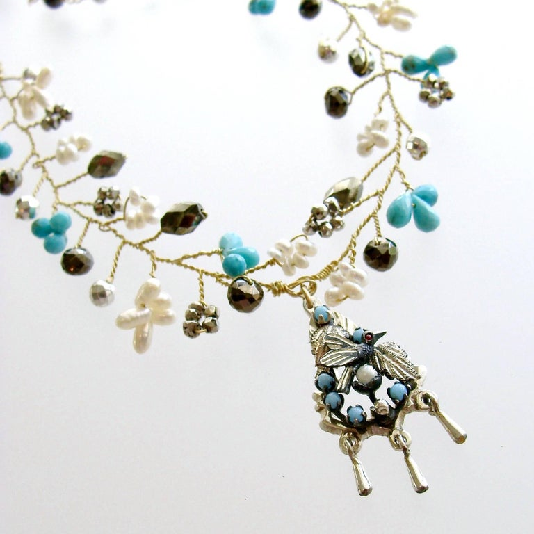 Pajaritos Flora Necklace.  A charming necklace with hand spun beads of micro turquoise teardrops and pearls, silver and natural pyrite - has been designed to replicate the flora and fauna of a woodland scene.  The mix of metals consisting of