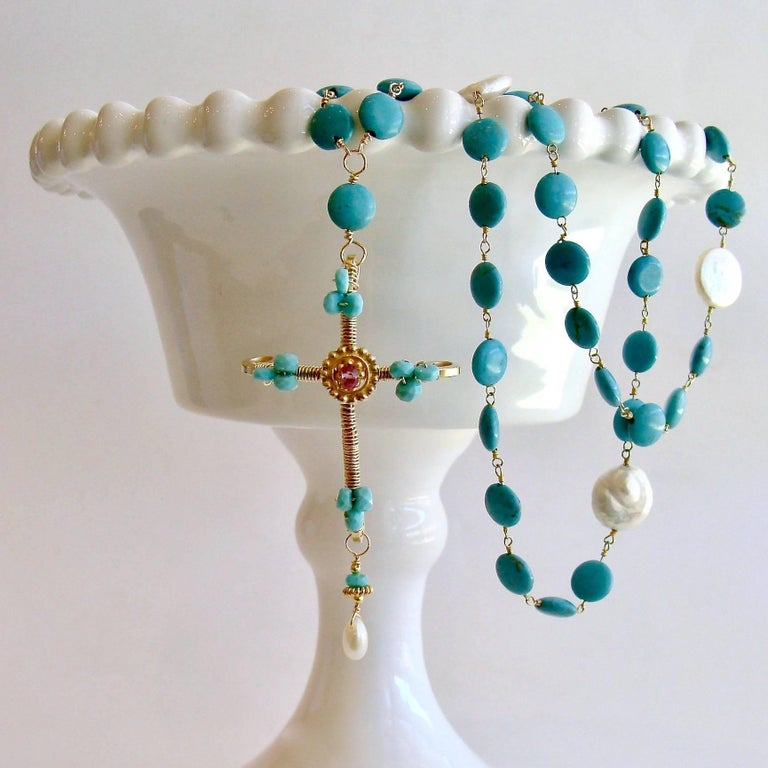 Cameron Cross Layering Necklace.  A gorgeous hand wrapped Byzantine style cross with Sleeping Beauty Turquoise and pink topaz accents has been married to a colorful chain of hand linked turquoise with coin pearls stations.  This nod to both religion