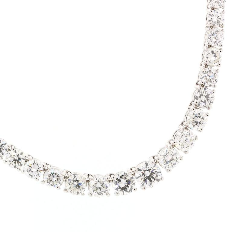 Gorgeously brilliant Riviere necklace.  Set with twenty nine carats of graduating Round Brilliant Cut Diamonds.  All diamonds are of G/H color - VS1/VS clarity and are prong set in  double wire settings.