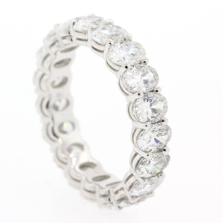 Precious eternity band fabricated in 18KT white gold, and accented with nineteen beautiful Oval Cut Diamonds weighing 4.82 carats of H color - VS1  clarity.  The  6 3/4 size band was made with perfection in mind.  Brilliantly Chic!
