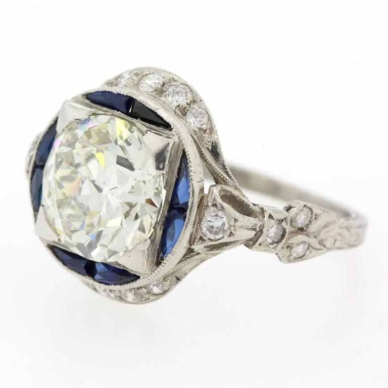 Splendid coveted 1920s platinum ring featuring a two carats ninety three Old European Cut Diamond, certified K color - VS2 clarity. The beautifully hand engraved platinum ring is accented with eighteen Old European cut Diamonds and eight calibrated