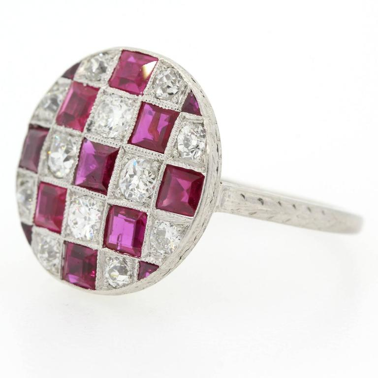 A unique checker design 1920s platinum ring set with nine square cut Burma Rubies and one carat fifteen of Old European Cut Diamonds of H color - VS clarity.  The setting is accented with hand engraving wheat design and enhanced with time worm