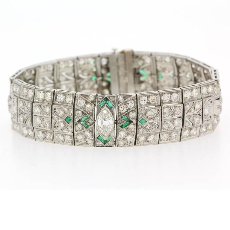Impressively coveted Art Deco bracelet centering one twenty-five carats of Marquise Cut Diamonds and accented with twelve and half carats of Old Cut Diamonds.  The seven inch long bracelet is enhanced with calibrated Colombian Emeralds at the