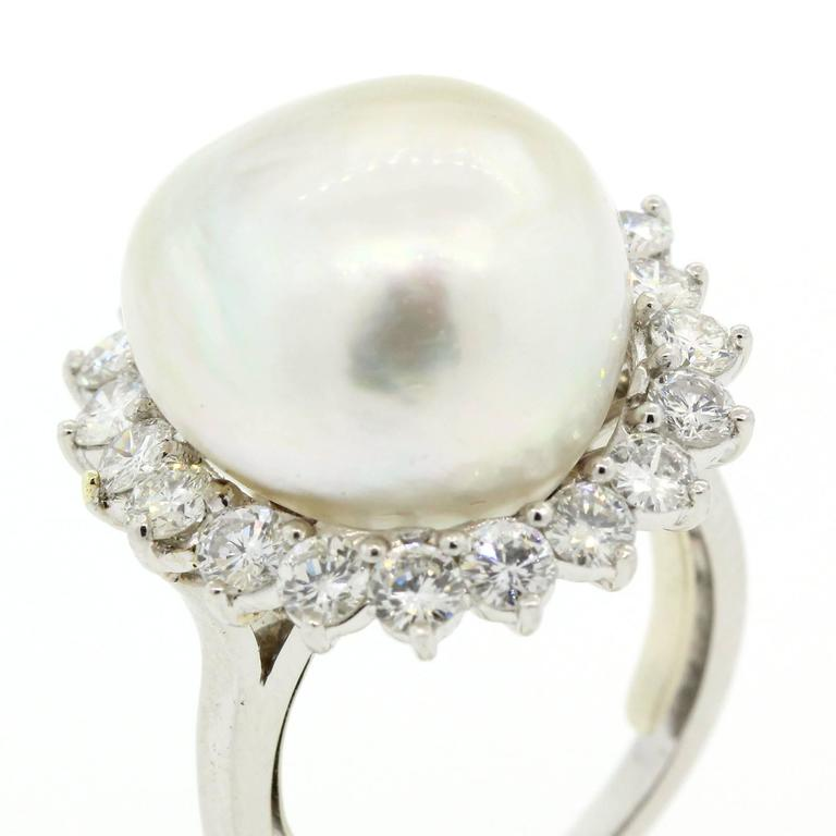 This 1970s platinum ring features a beautiful 16 mm White South Sea Pearl.  The baroque shape Pearl is surrounded by two carat eighty of Round Brilliant Cut Diamonds of G/H color - VS1 clarity.  This is the perfect cocktail ring!