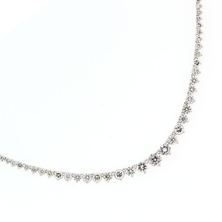 A beautiful 18KT white gold necklace prong set with graduating diamonds.  This  brilliant necklace is set with ten carat of Round Brilliant Cut Diamonds of H color - VS clarity.   This is a perfect Valentine's gift!