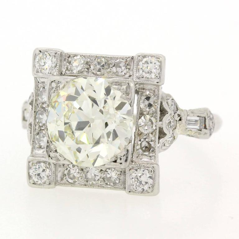 Splendorous Art Deco ring featuring a 2.40 carat Old European Cut Diamond, certified E.G.L. USA N color - VVS2 clarity.  The diamond is set in a square platinum setting accented by four Old European Cut and twelve old Single Cut Diamonds.  The sides