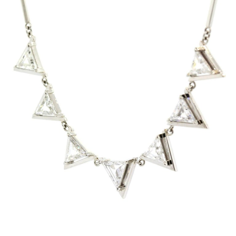 """A one of a kind platinum necklace featuring seven Triangle Cut Diamonds weighing 2.00 carats.  The diamonds are H color - VS clarity, and each is framed in a open triangular plaque suspended from a 16"""" long bar link chain."""