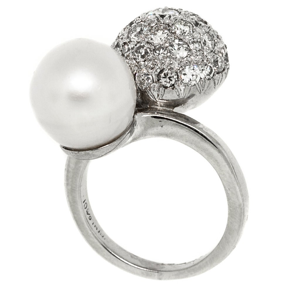 Celebratory and chic, this Vintage piece from the 1960s symbolizes the decade as the height of mod fashion.  The bypass ring is comprise of a 11.65 mm South Sea White Pearl and Platinum ball pave set with 1.85 carats of white Diamonds.  Fashionably