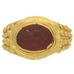 Museum Quality Roman Gold Ring with Cupid Intaglio circa 3rd Century AD