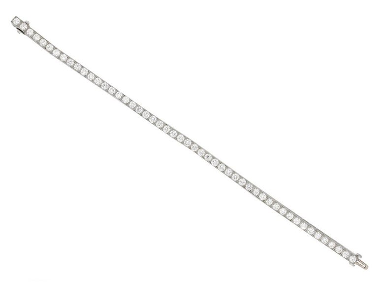 Tiffany & Co. diamond set line bracelet. Set with fifty round old cut diamonds in open back grain box collet settings with a combined approximate weight of 7.50 carats, to an elegant line bracelet consisting of articulated collets with fine open