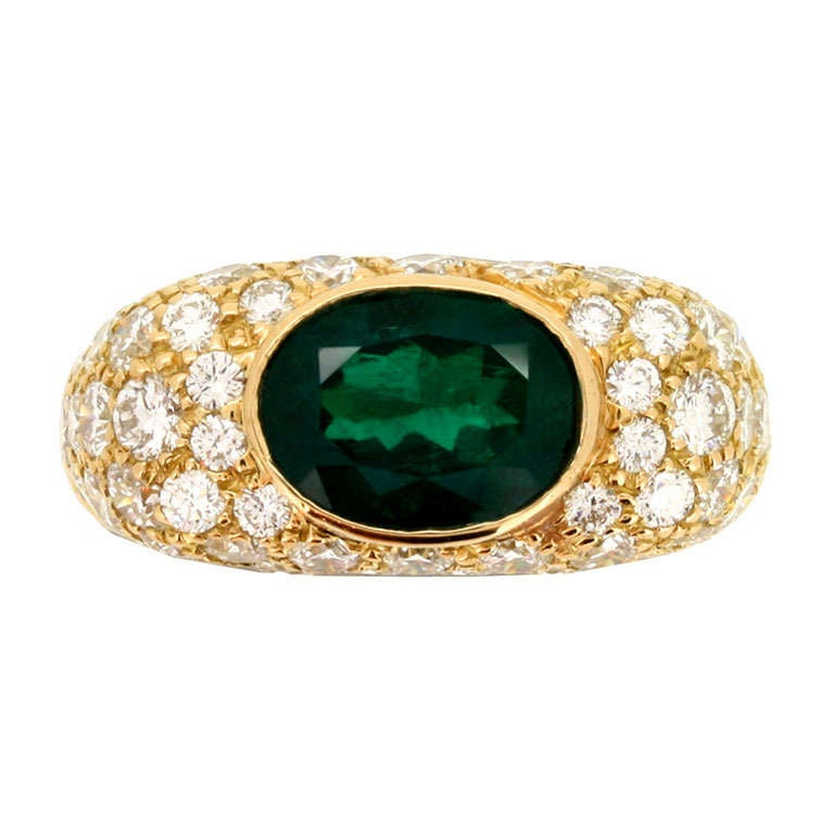 Natural Colombian emerald & diamond cluster ring by Oscar Heyman Brothers