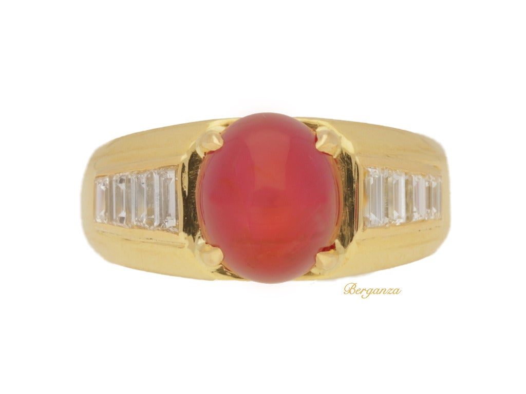 Van Cleef & Arpels Burmese star ruby and diamond ring. Set centrally with a oval cabochon natural unenhanced Burmese star ruby in an open back four claw setting with an approximate weight of 4.97 carats, flanked by eight rectangular baguette cut