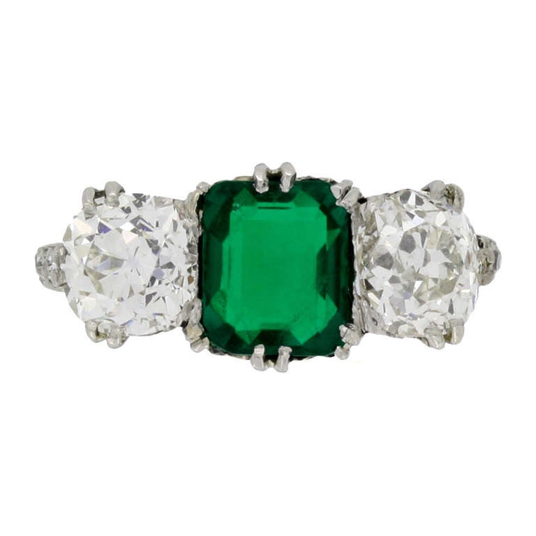Natural Unenhanced Colombian emerald and diamond three stone ring, circa 1910.