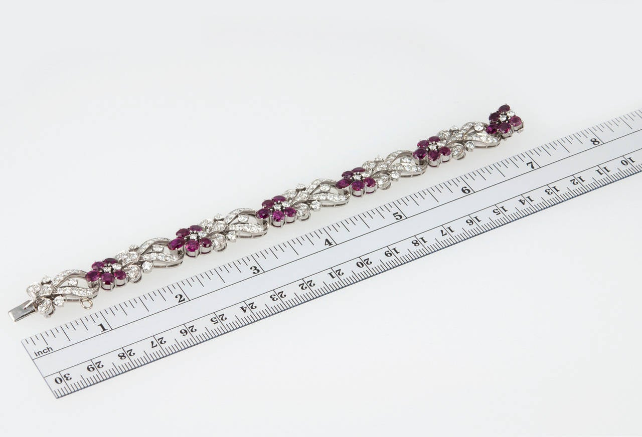 This stunning link bracelet was made by Tiffany & Co. in a floral motif and contains 30 natural rubies and approximately 6 carats of round brilliant diamonds. The bracelet was constructed in palladium, which leads us to believe it was made