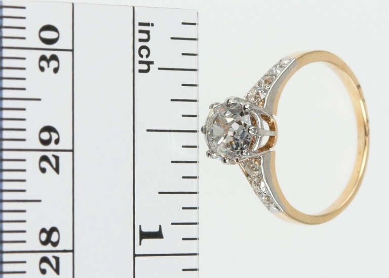 Victorian Splendor!  A 1.25ct H-SI1, ELG Certificate,  Old Mine Cut diamond is in the center of a Platinum topped 14 karat yellow gold mounting.  6 diamonds are set into the mounting.  Circa 1900.  It is size 5 3/4 and is easily altered.