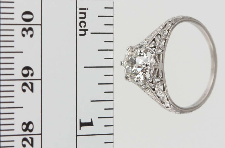 This beautiful Edwardian platinum ring features a 1.17 carat G-VS1 (EGL) Old European cut diamond with two small diamonds on the shoulders and lots of intricate open-work and filigree, which gives a lovely, light and feminine feeling to this very