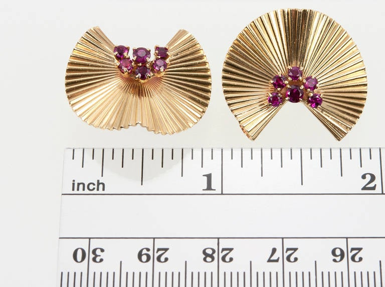 Tiffany & Co. fluted clip earrings in 14 karat yellow gold embellished with six small round rubies on each clip, circa 1950. Very comfortable to wear!