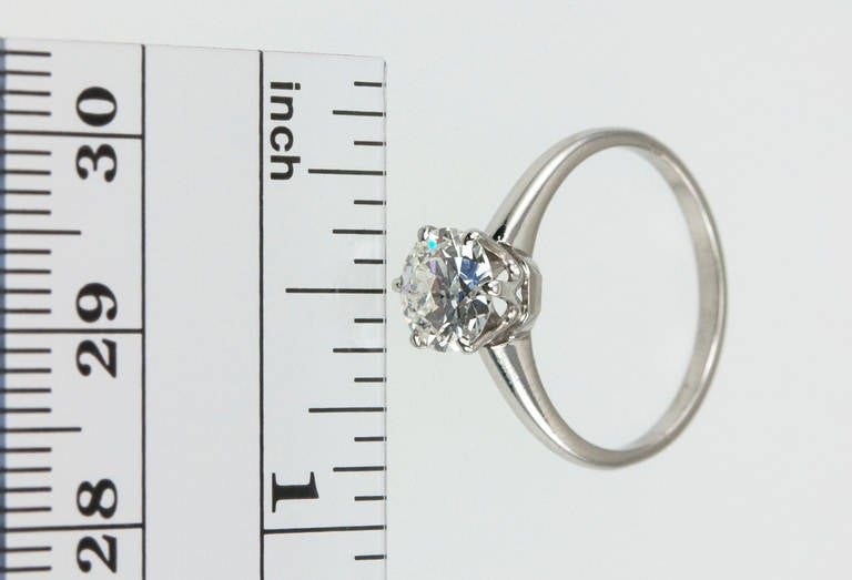 A classic and timeless platinum and diamond solitaire ring from the c1930s. The 1.01ct E-VS1 (EGL) Old European Cut diamond features a simple and elegant six prong setting that is raised above the band to allow maximum light to pass through the