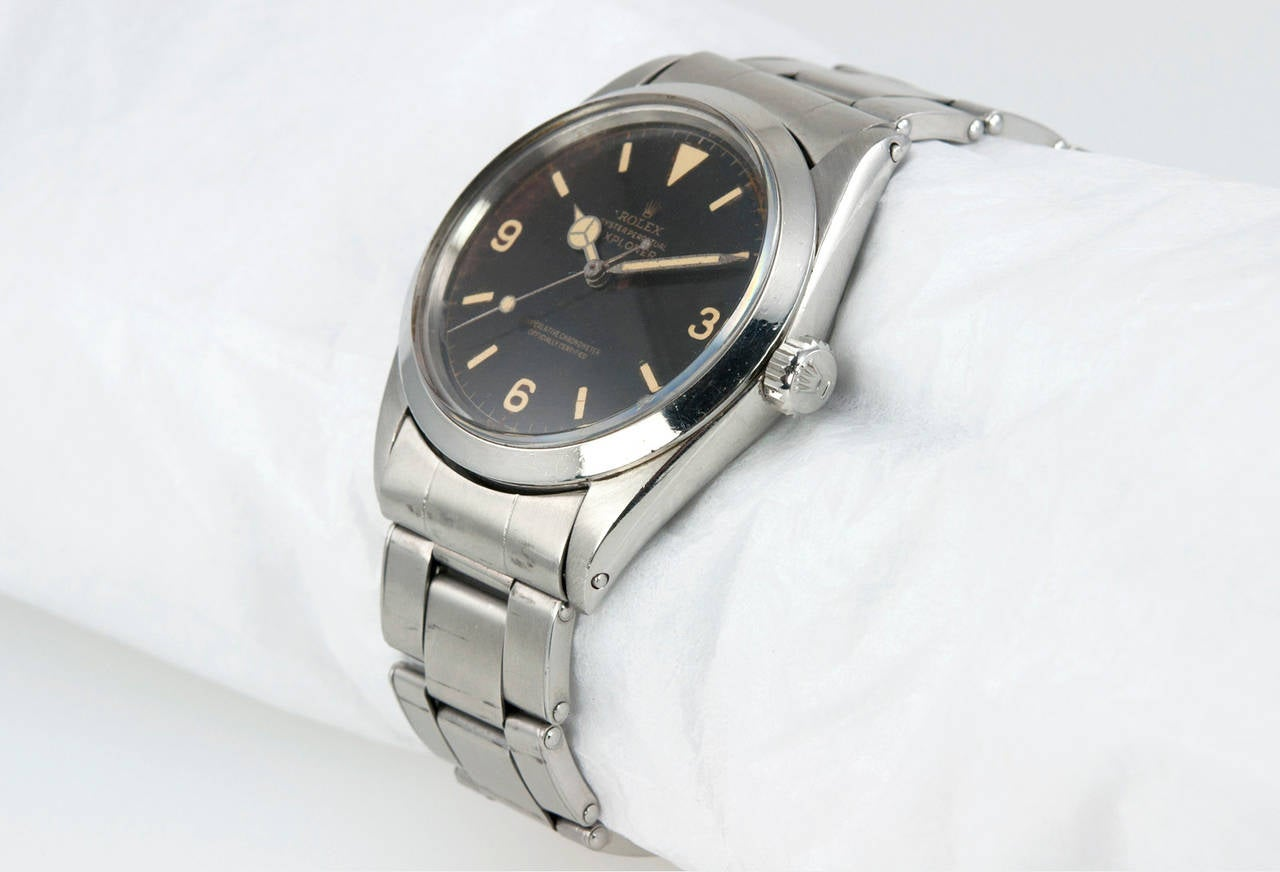 Rolex stainless steel Explorer wristwatch, Ref. 1016,  1966. This has a rare gilt dial, which features a plastic crystal and a waterproof crown, stainless steel riveted oyster band. The case is approximately 36 mm in width.