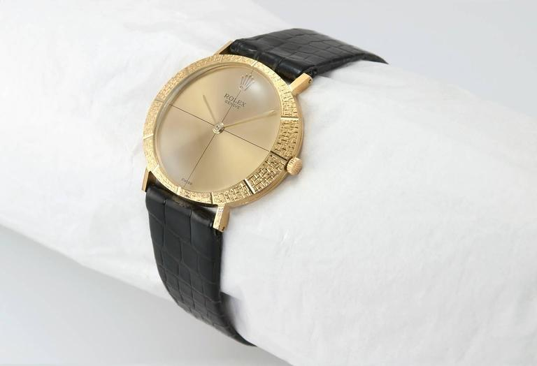 Rolex dress wristwatch, reference 3613. This beautiful Rolex is a manual wind watch and features a textured 18 karat yellow gold case with a classic gold dial, a yellow gold crown, round glass crystal, with a 18 karat yellow gold watch case, on the