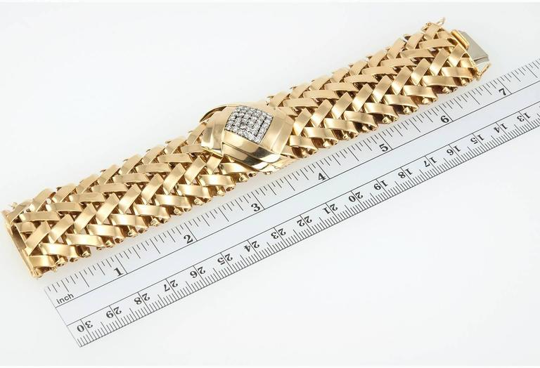 Vacheron & Constantin ladies 18 karat yellow gold woven style bracelet with hidden watch. This magnificent piece features 36 round brilliant cut diamonds, totaling approximately 1.50 carats of diamonds that are G/H in color and  VS2 in clarity. The