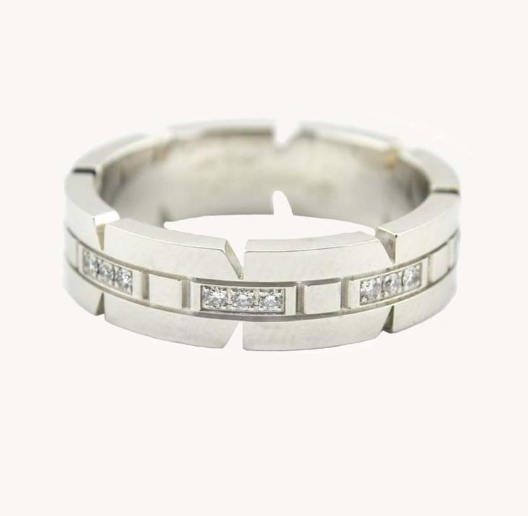 """Cartier Tank Francaise band in 18 karat white gold circa 2000s.  This Cartier """"small model"""" ring features 24 brilliant-cut diamonds, which total approximately 0.17 carats in total diamond weight.  Cartier signed and numbered.    This"""
