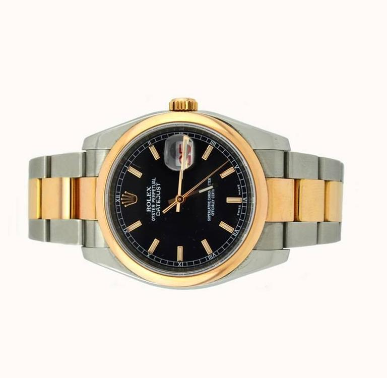 Rolex DateJust wristwatch, reference 116201. A modern Rolex in 18 karat Everose gold and stainless steel, which features an 18 karat Everose gold smooth bezel, a locking waterproof Everose gold crown, a black stick dial, and a 18 karat Everose gold