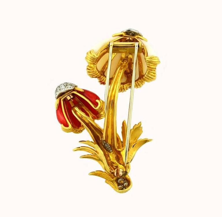 Van Cleef & Arpels mushroom brooch in 18 karat yellow gold.  This incredible brooch features a red and white coral in the shape of mushrooms with diamond accents. Circa 1960.  This brooch measures approximately 2.67 inches in height and 1.63