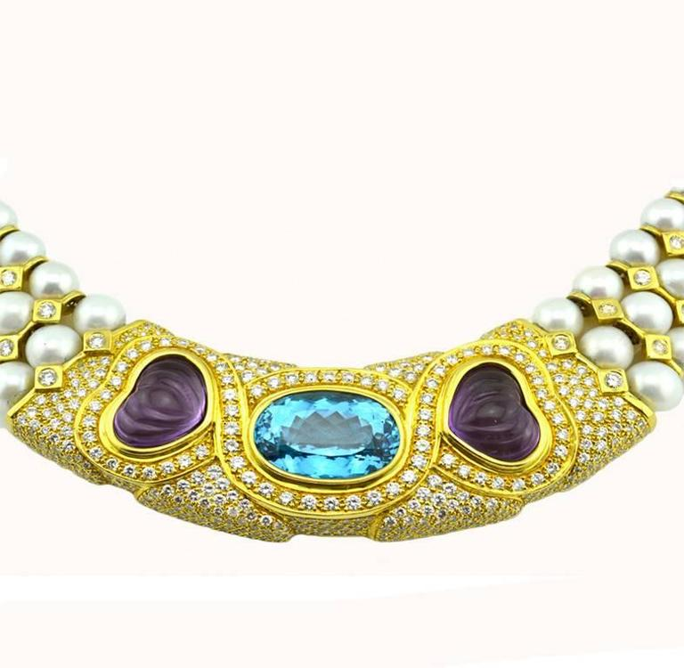 A pearl collar/choker necklace in 18 karat yellow gold from circa the 1980s.  This necklace features three rows of pearls with round brilliant diamonds set throughout the necklace for approximately 15 carats in total diamond weight.  A 35 carat