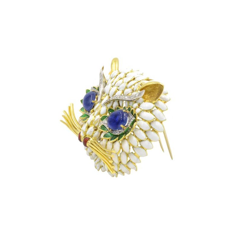 Huge 18k yellow gold Italian Kitty Cat Brooch in white, red, and green enamel with sapphire and diamond eyes.  The cabochon sapphires are approximately 2 carats each.  Approximately 0.60 carats of round diamonds.  Just over 2 inches wide.  Italian