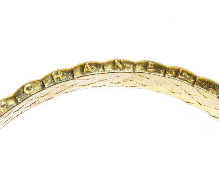 Rare Chanel 18K gold and diamond Matelasse flexible bracelet from Gem de la Gem.  Fits 6.5 wrist well. Pristine condition.