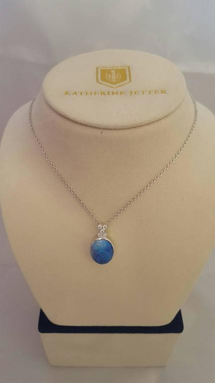 This ageless and timeless pendant is set in 18K White Gold with a 9.33ct Boulder Opal, 0.17ct White Diamond bezel set accents on bail with signature turtle clasp chain. The perfect transition piece from day to night - pairs beautifully with our