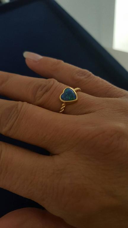 This sweet and dainty Heart Ring is perfect for everyday wear. Hand-carved 0.78ct Opal heart bezel set in 18K Yellow Gold. Ring size US 5.5.