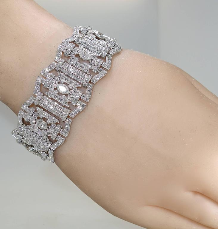 The platinum work is superb.  See the engraving on the sides and the clasp.  The back of the bracelet is well azured out a hallmark of wonderful workmanship.  The 15 cts. of diamonds are all near colorless (H) and very slightly included.  The