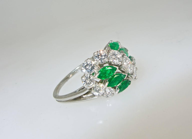 Signed and numbered by the world famous House of Cartier, this ring possesses 1.75 cts. of fine white diamonds and .70 cts. of bright green emeralds.  The ringis now a size 6.5 and can easily be sized.