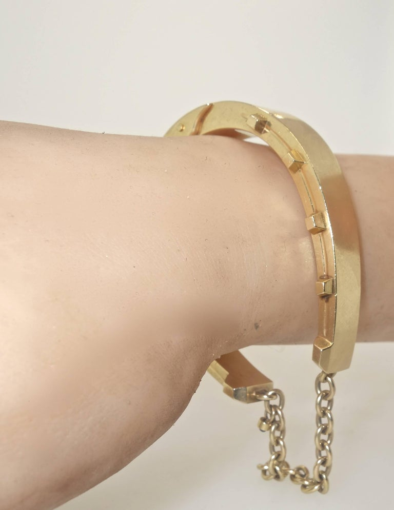 Unusual in design, this gold bangle bracelet opens up wide so that the wrist slips on with ease.  It is an unusual design as it appears as a bold gold bracelet, but the observer soon see that it is in fact the motif of a classic horse shoe.