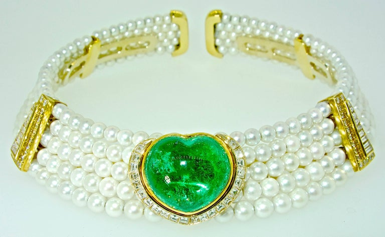 In the style and workmanship, of the great designer Marina B. (but not signed), this striking necklace centers an important fine natural emerald weighs approximately 25+ cts.   This natural large emerald is probably Colombian and displays a pleasing
