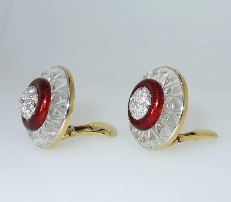 David Webb (during his lifetime - pre-1976) unusual earrings centering a total of 14 fine white brilliant cut diamonds weighing approximately 1.5 cts and surrounded by intense red guillochee enamel all within a frame of carved rock crystal weighing
